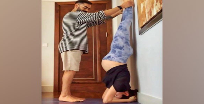anushka sharma sets fitness goals as she aces headstand with husband kohlis help