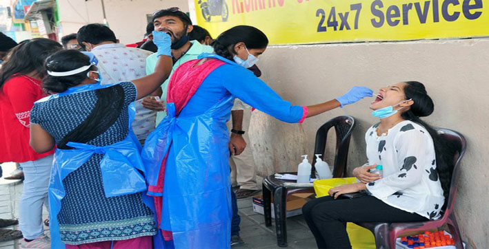 India reports 2,61,500 new COVID-19 cases, 1,501 deaths