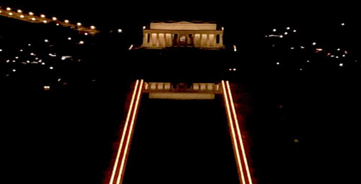 national mall illuminated with pillars of light field of flags for americans who cant attend bidens inauguration