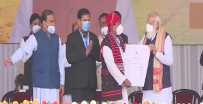 pm modi distributes land allotment certificates to indigenous people in jerenga pathar sivasagar