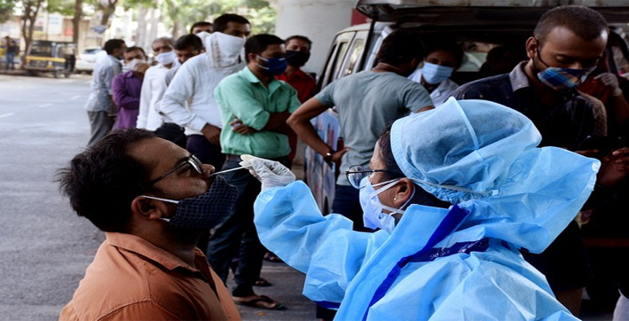India reports highest single-day spike with 3,32,730 new COVID-19 cases, 2,263 deaths
