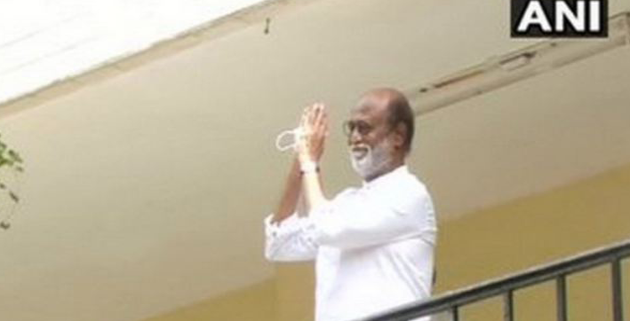 rajinikanth greets supporters after meeting with his party leaders