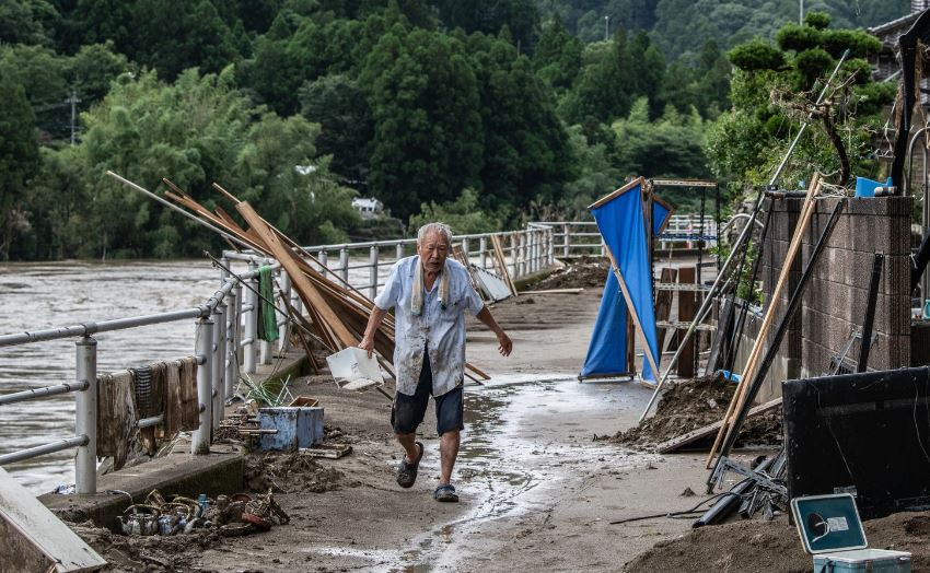 japan battered by more heavy rain floods deaths rises to 58